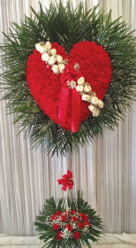 RED CARNATION BROKEN HEART WITH PALM LEAF