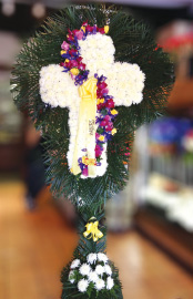 WHITE CARNATION CROSS WITH PURPLE SWIRL AND PALM LEAF